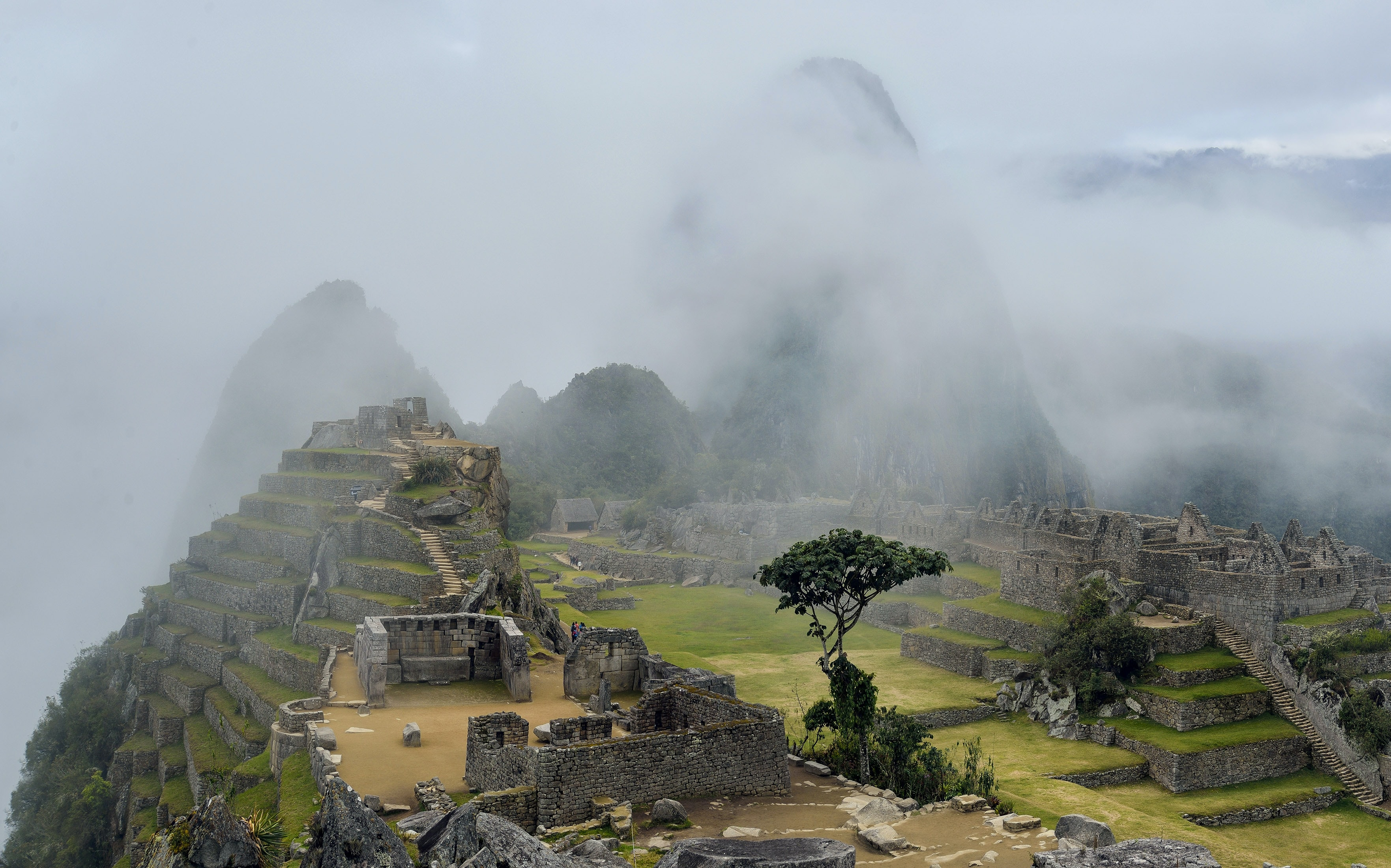 Historic ruins of Machu Picchu cover in fog
