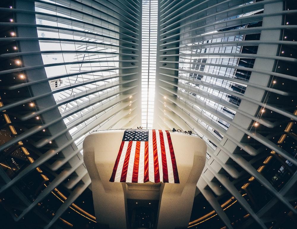 bottom photography of grey metal building and USA flag