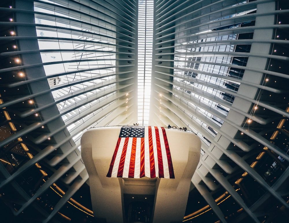 bottom photography of grey metal building and USA flag