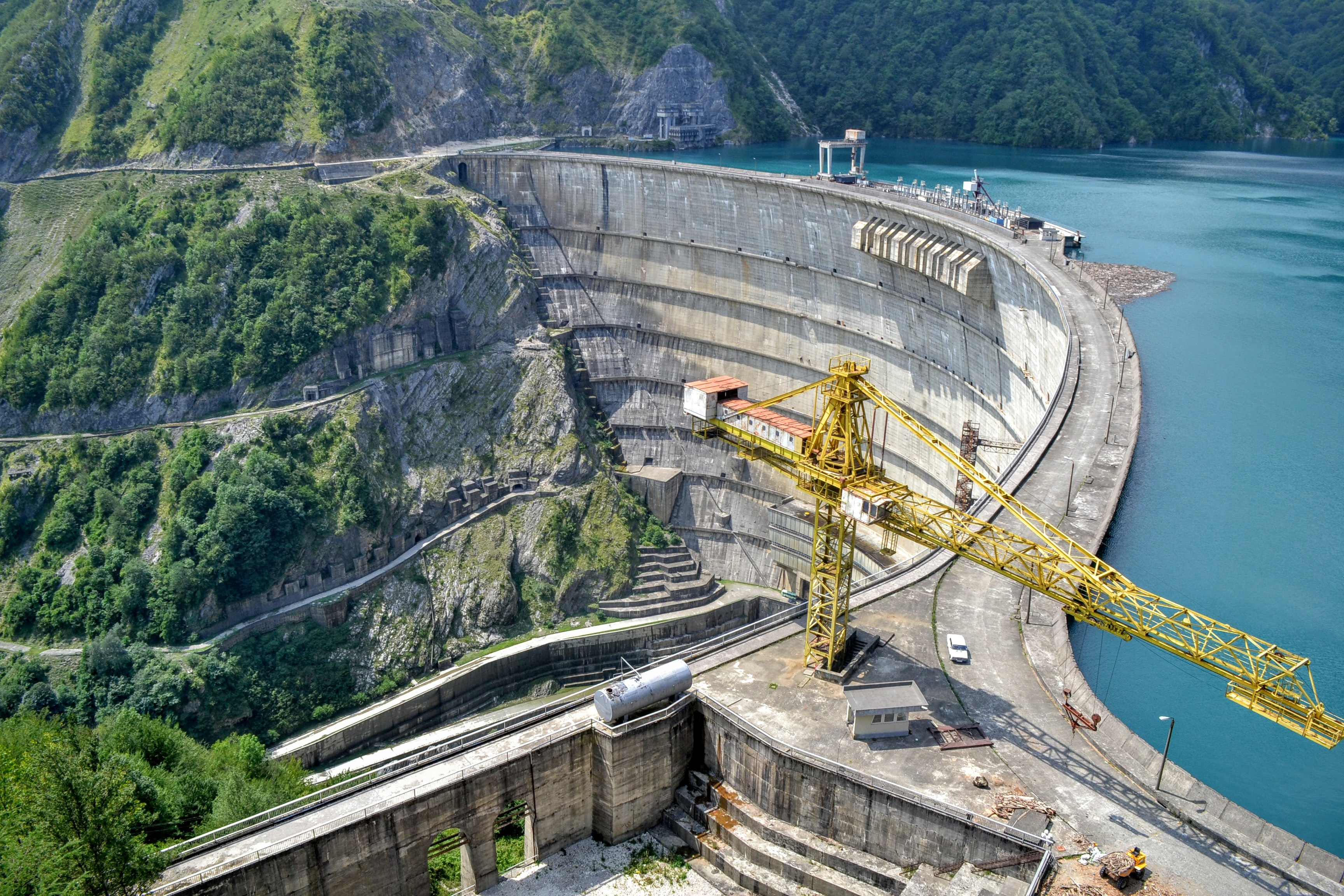 A low crane on a dam on a lake