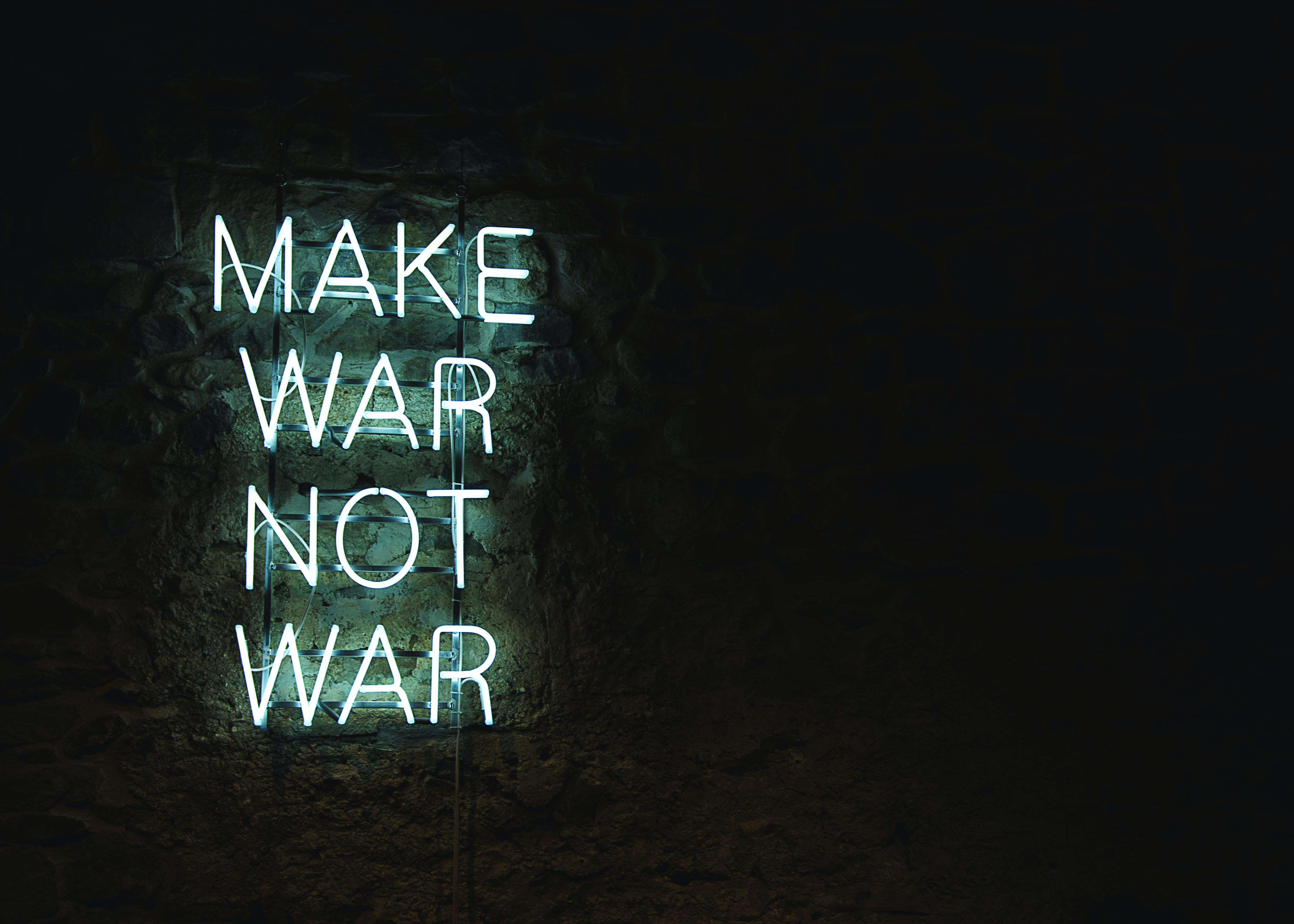 green make war not war LED signage