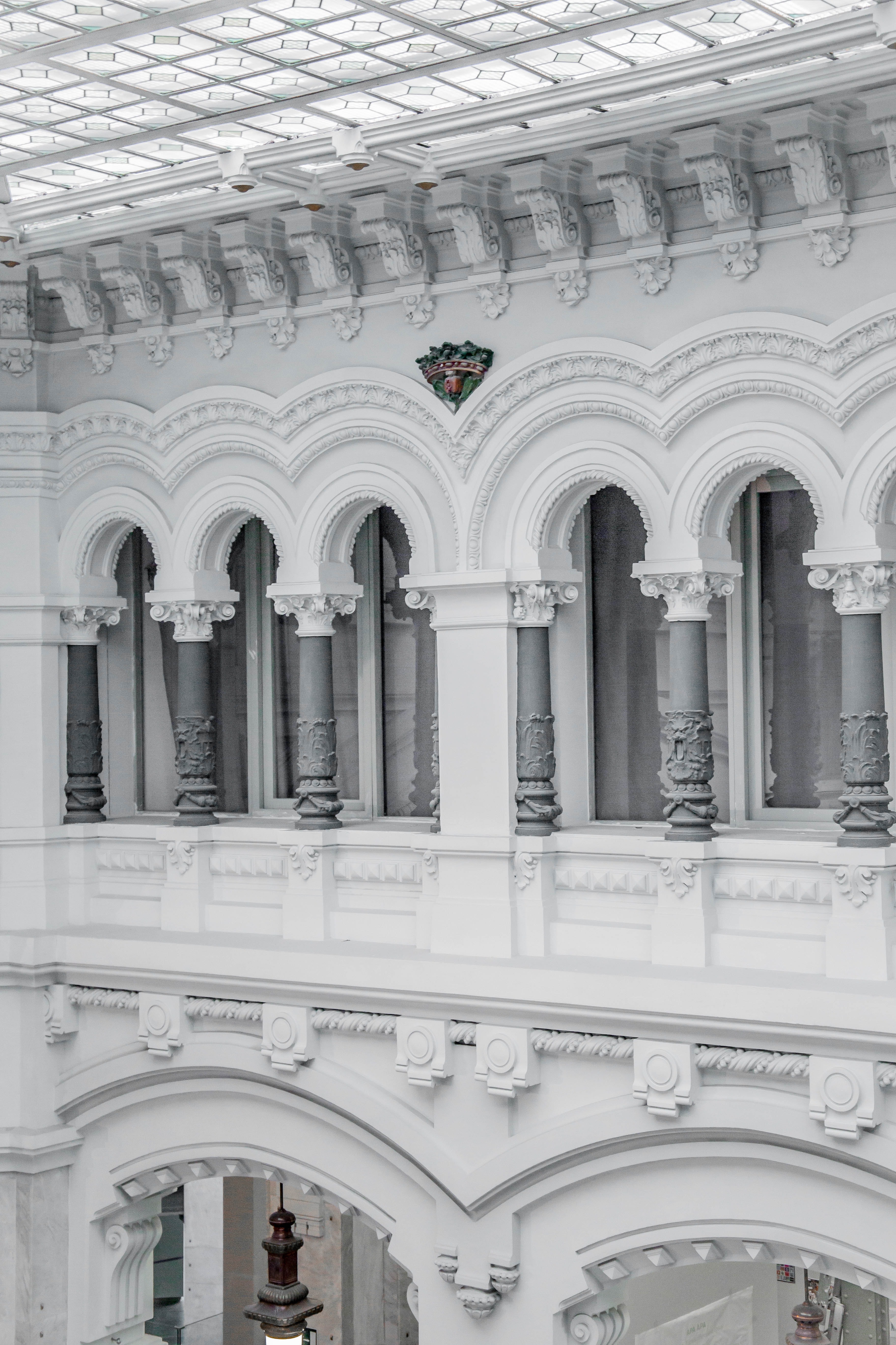 The facade of a building in Madrid has the classical architecture with Corinthian columns.