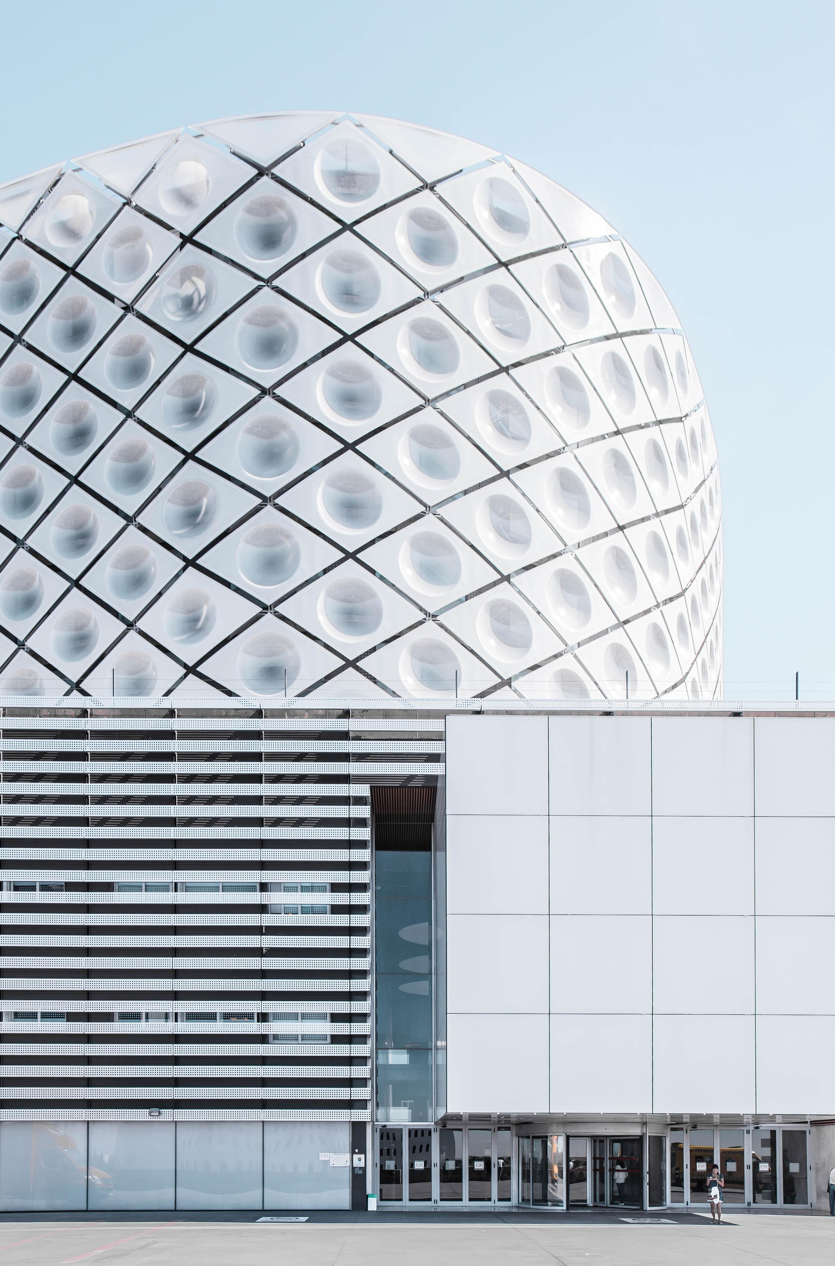 A modern geometric building design in Madrid.
