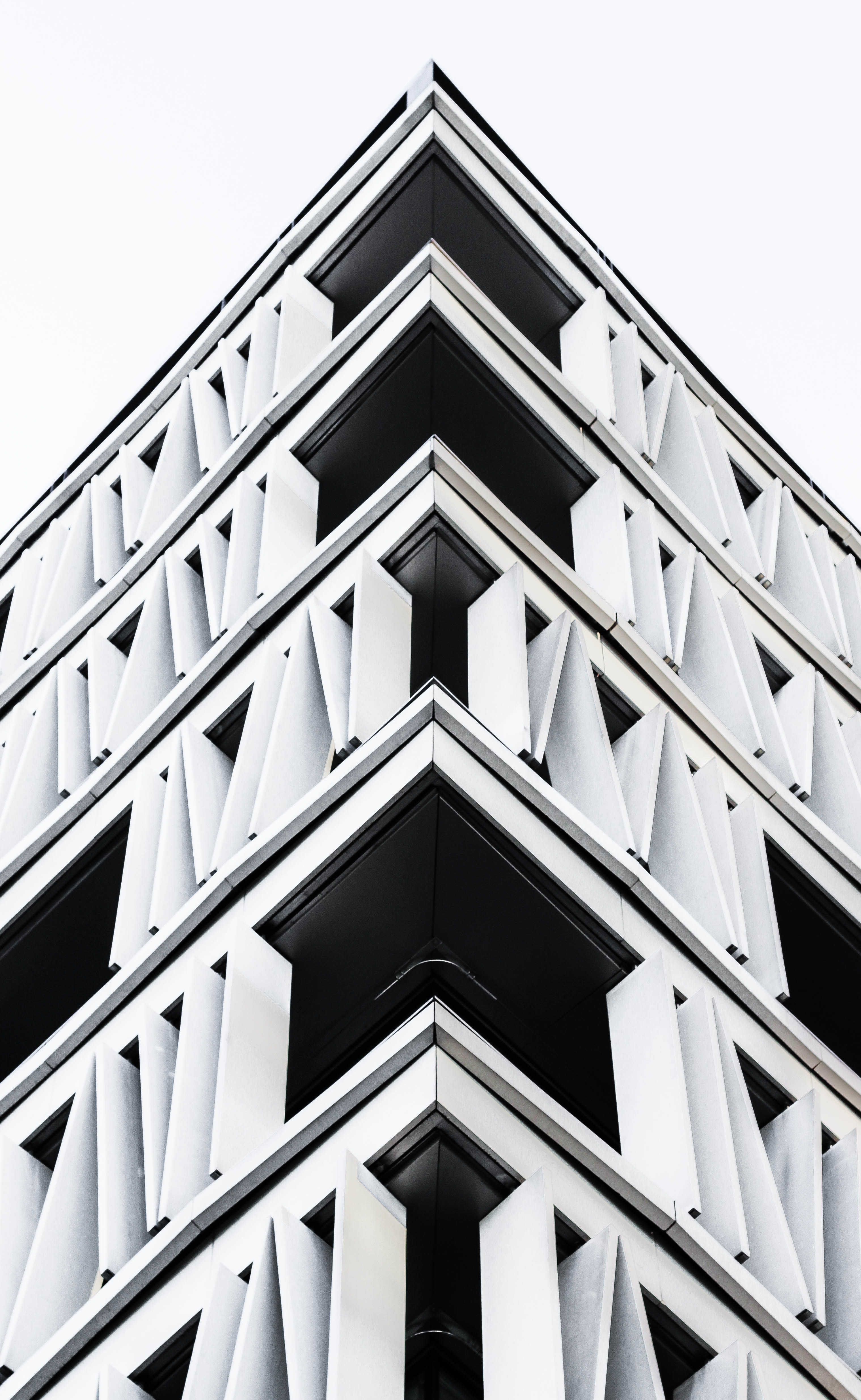 The corner of a building with a modern white and black facade