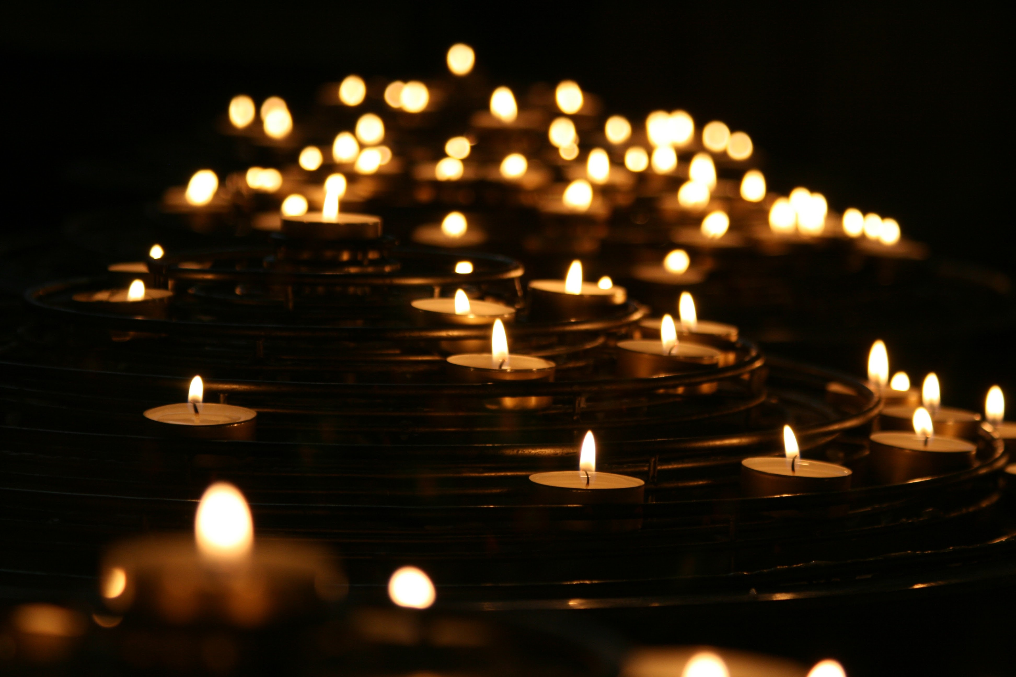 low-angle photo of lightened candles