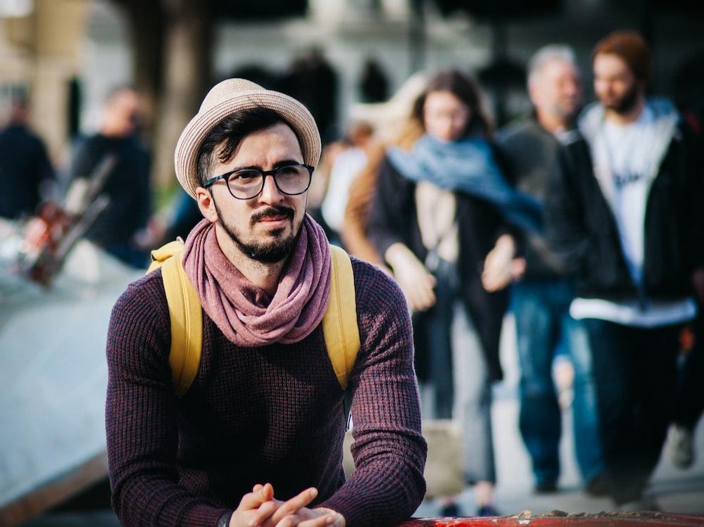 man wearing brown fedora hat