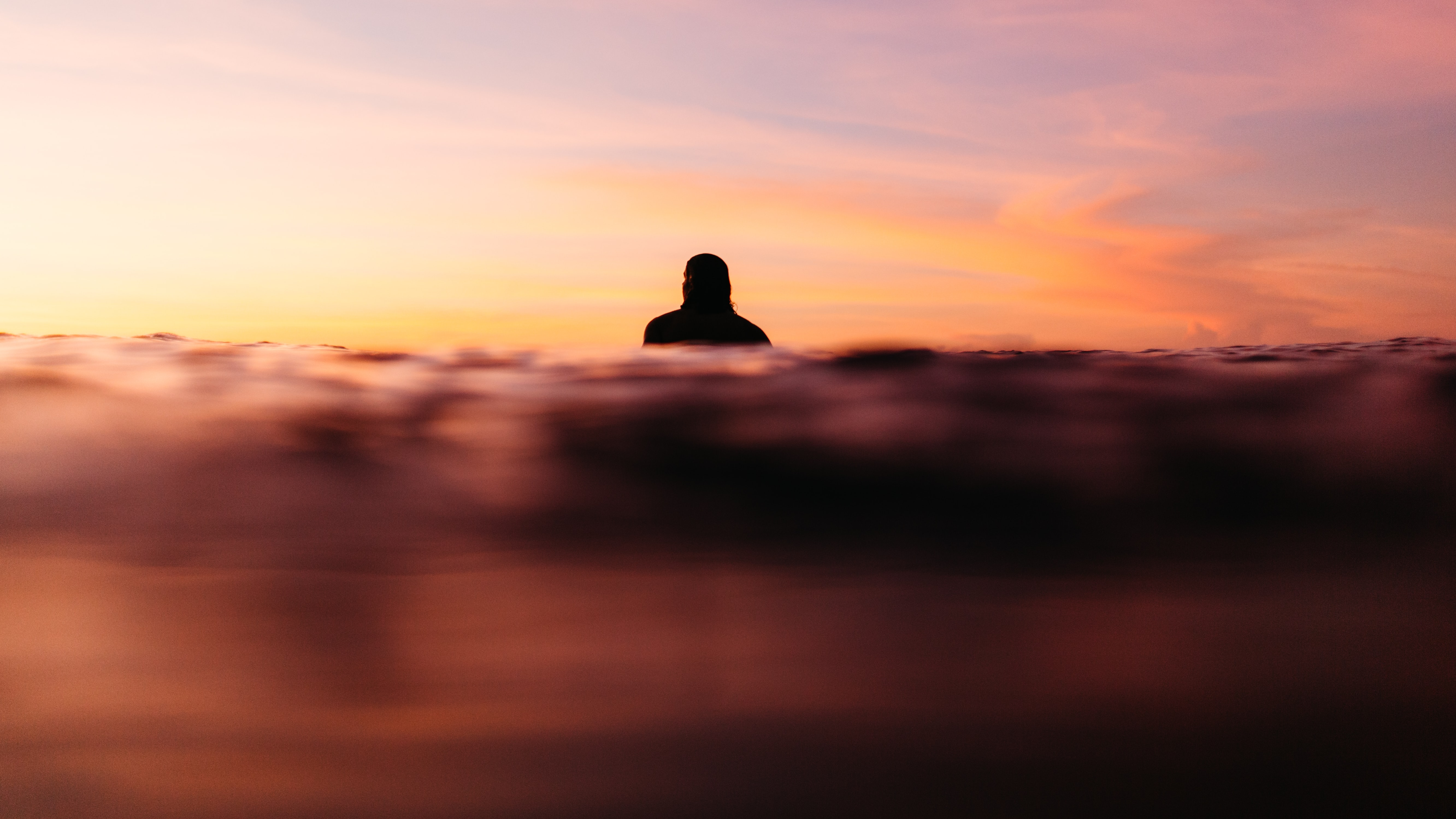 silhouette photo of person in body of water
