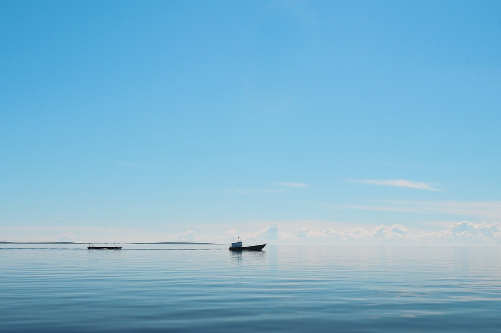 silhouette of boat on the ocean