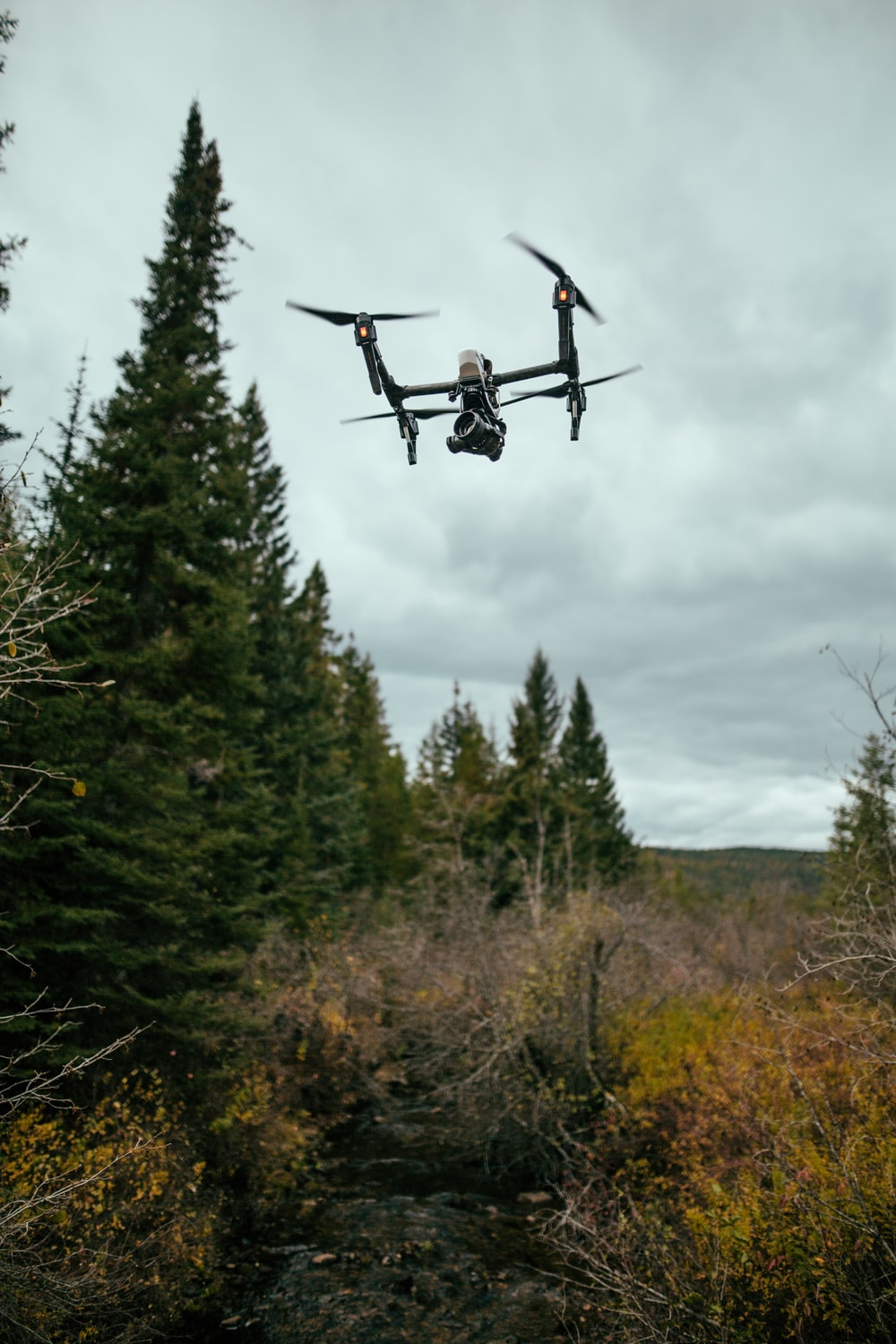 quadcopter drone flying in mid-air during daytime