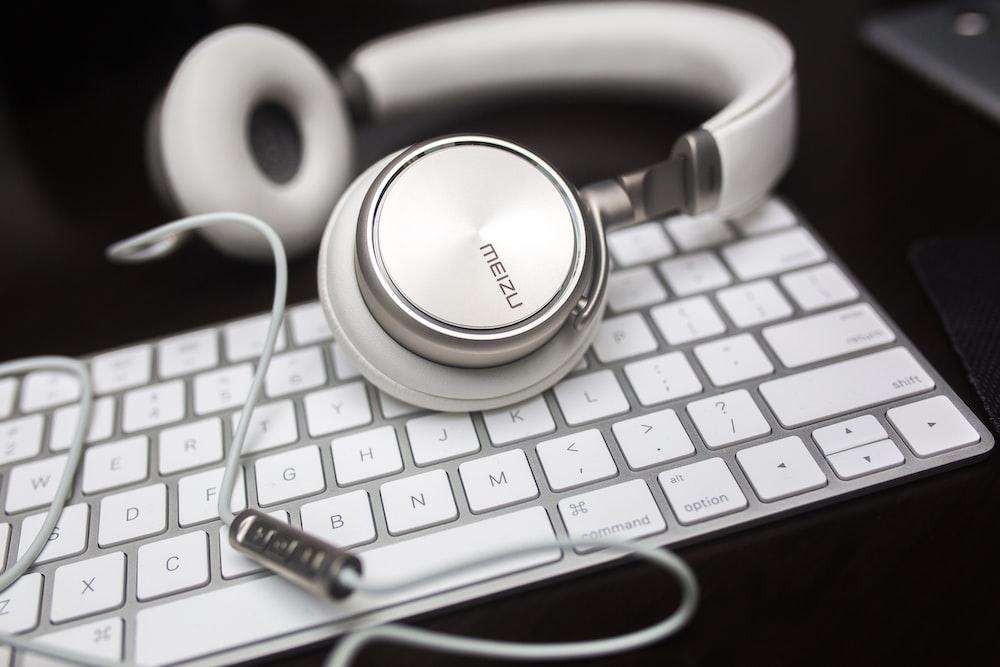 white Menzu corded headphones on Apple Magic keyboard