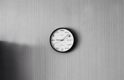 round white and black analog watch reading at 9:10