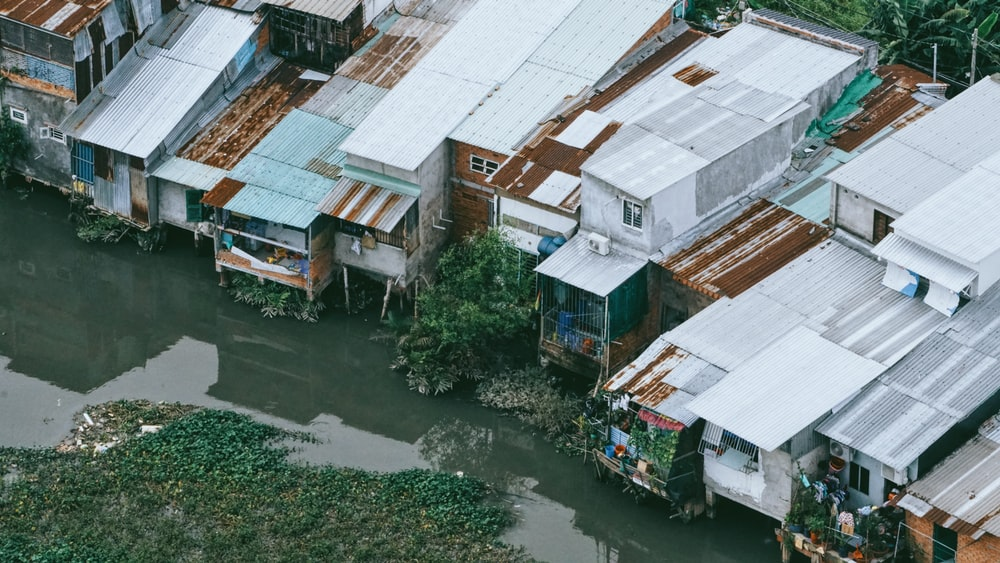 aerial photo of body of water between houses
