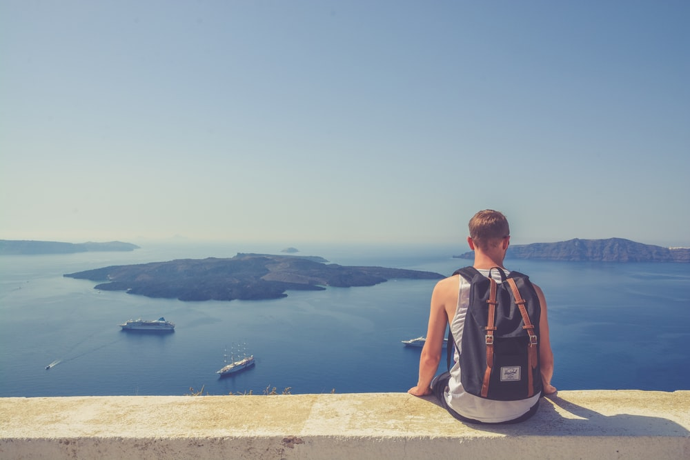 man sitting facing island
