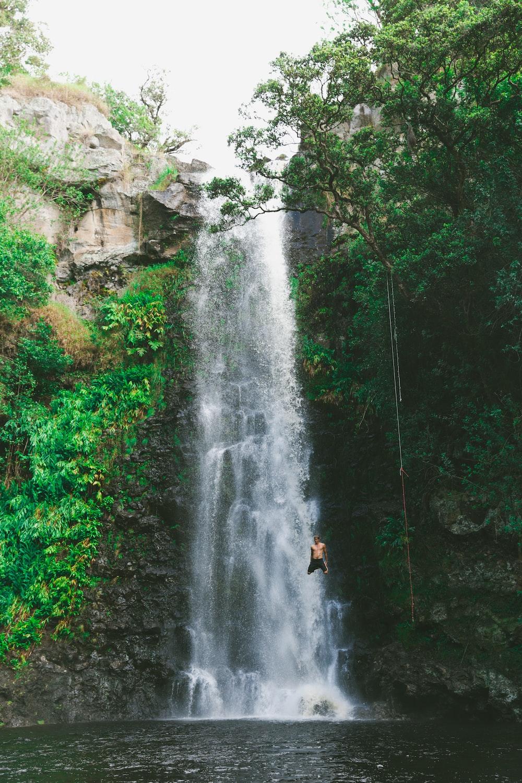 man jumping waterfalls
