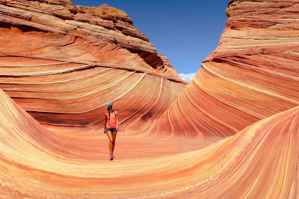 woman walking near canyon