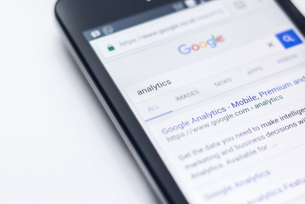 "A Google search page for the word ""analytics"" on a mobile phone"