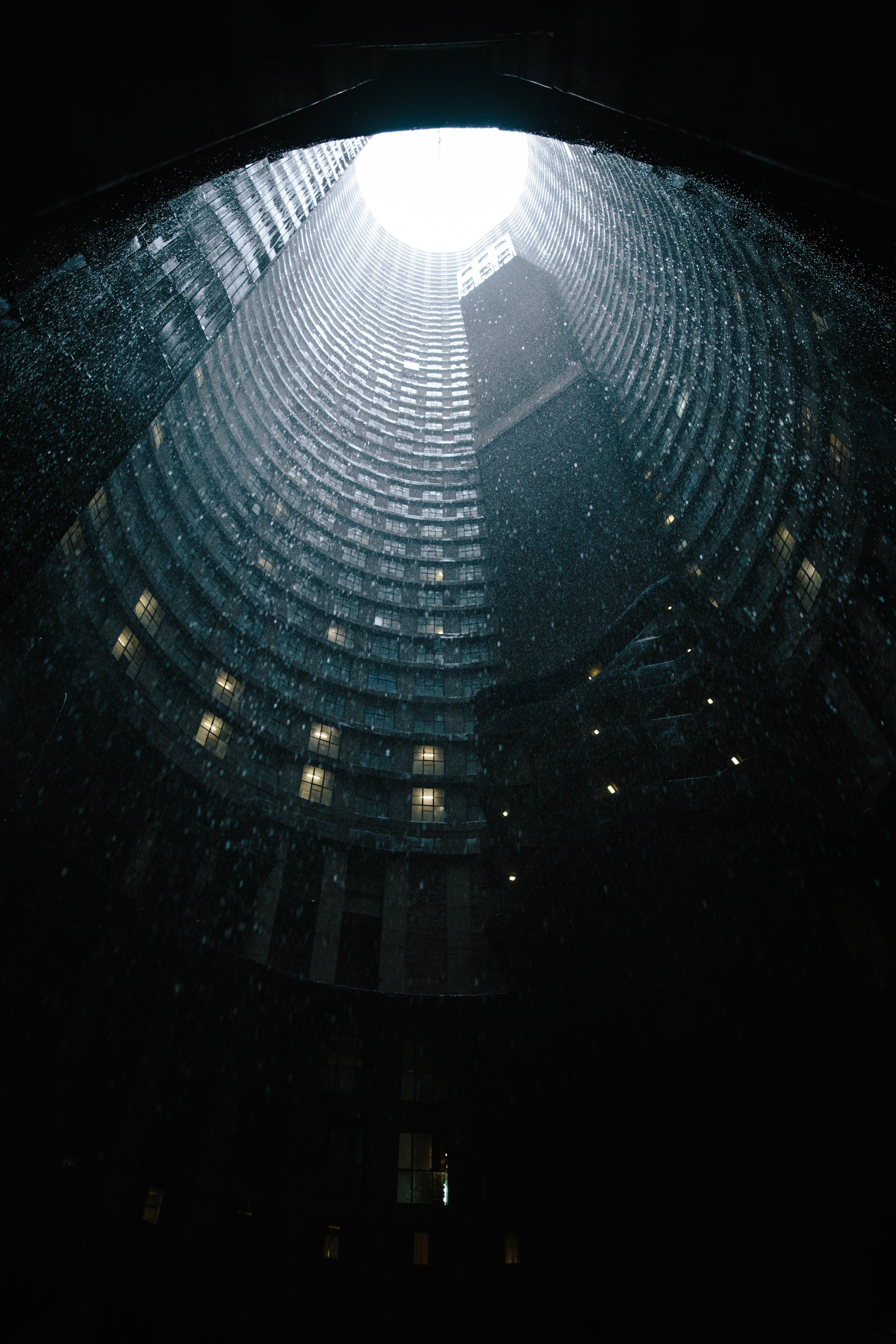 A dramatic shot of the core of the Ponte City Tower in Johannesburg under heavy rain