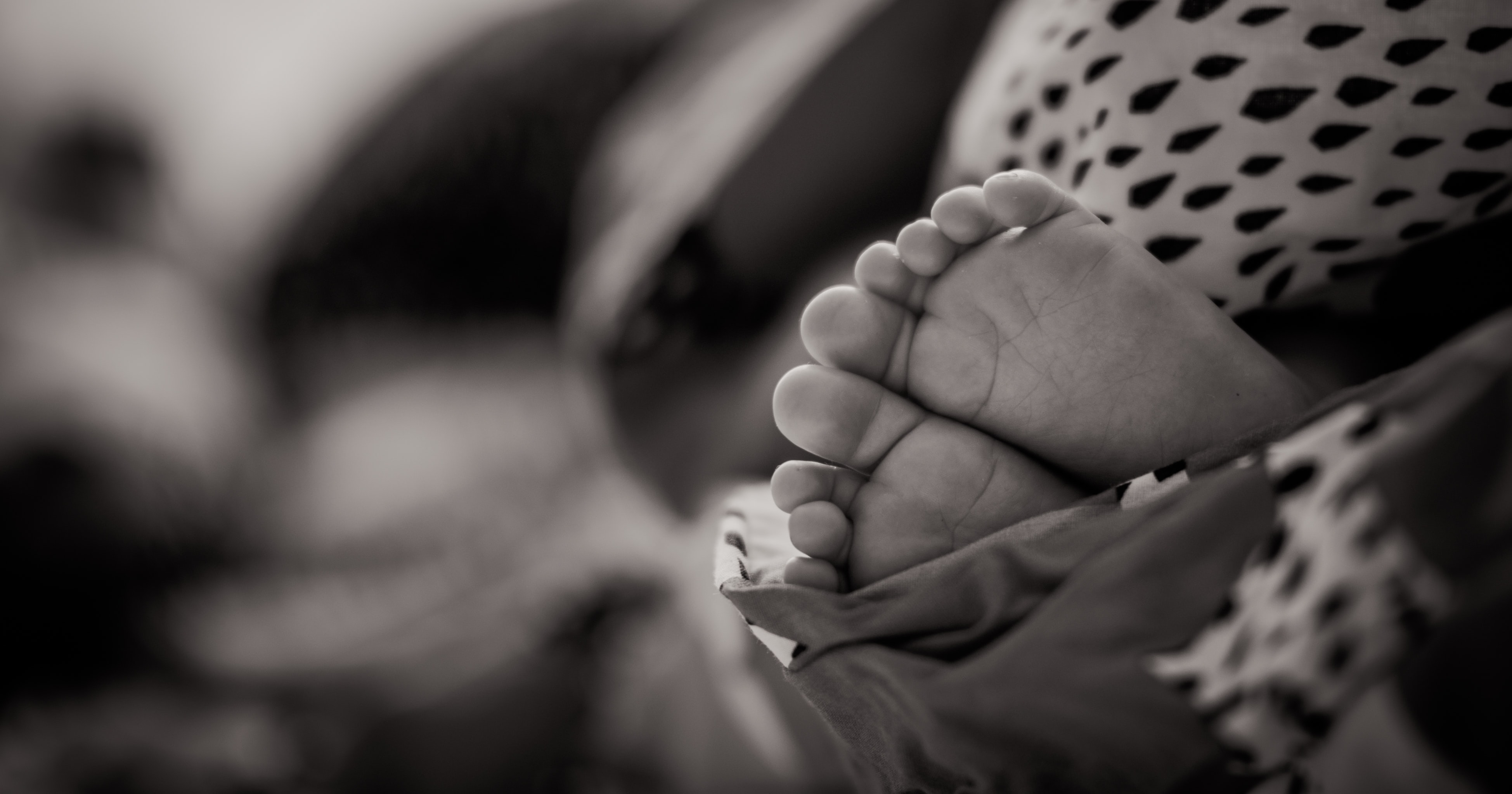 grayscale photo of baby's feet