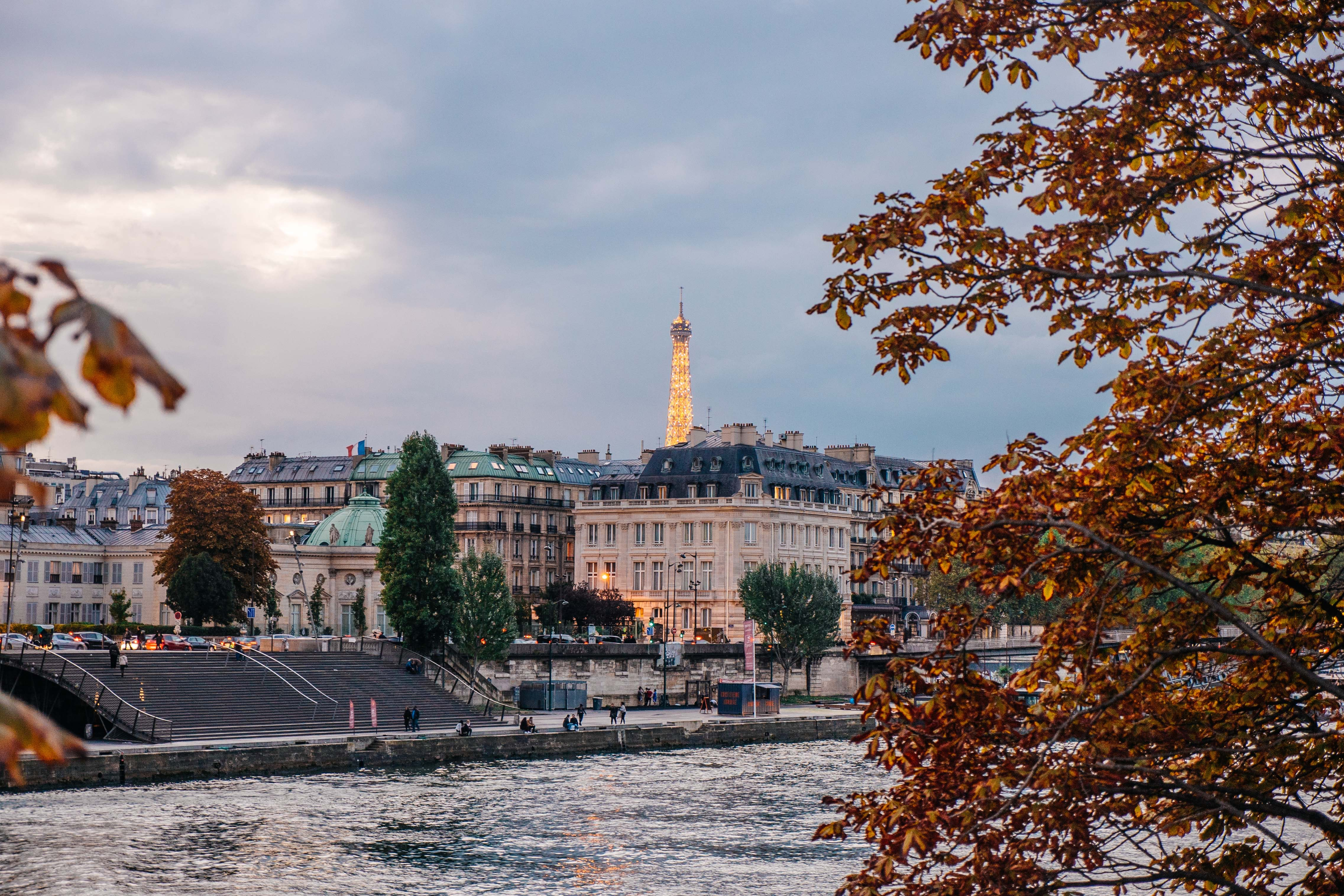 The Seine River in Paris during Autumn with buildings and the Eiffel Tower in the distance