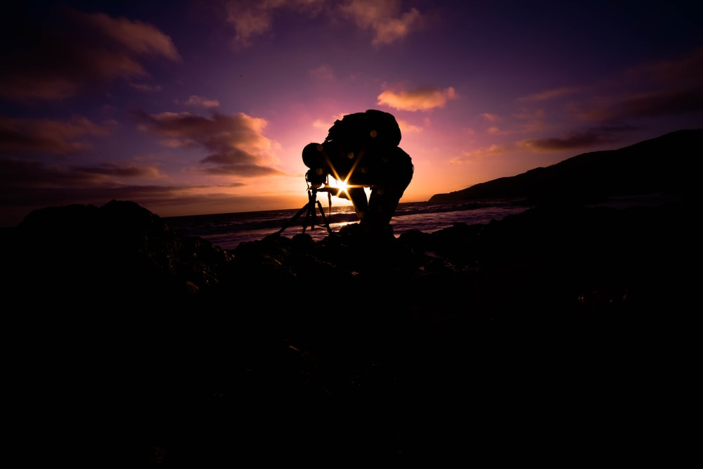 silhouette view of man bending under golden hour