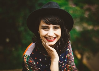 woman with red lipstick smiling
