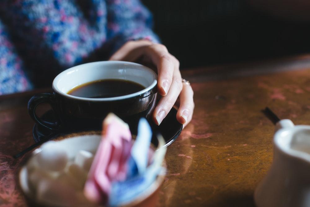 person drinking tea