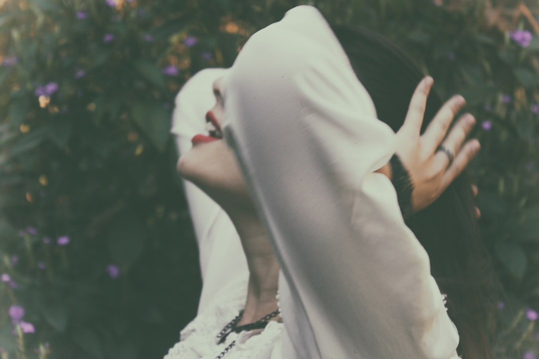 Woman White Tying Hair