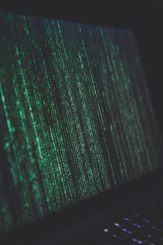 Green Matrix-style code raining down a computer screen
