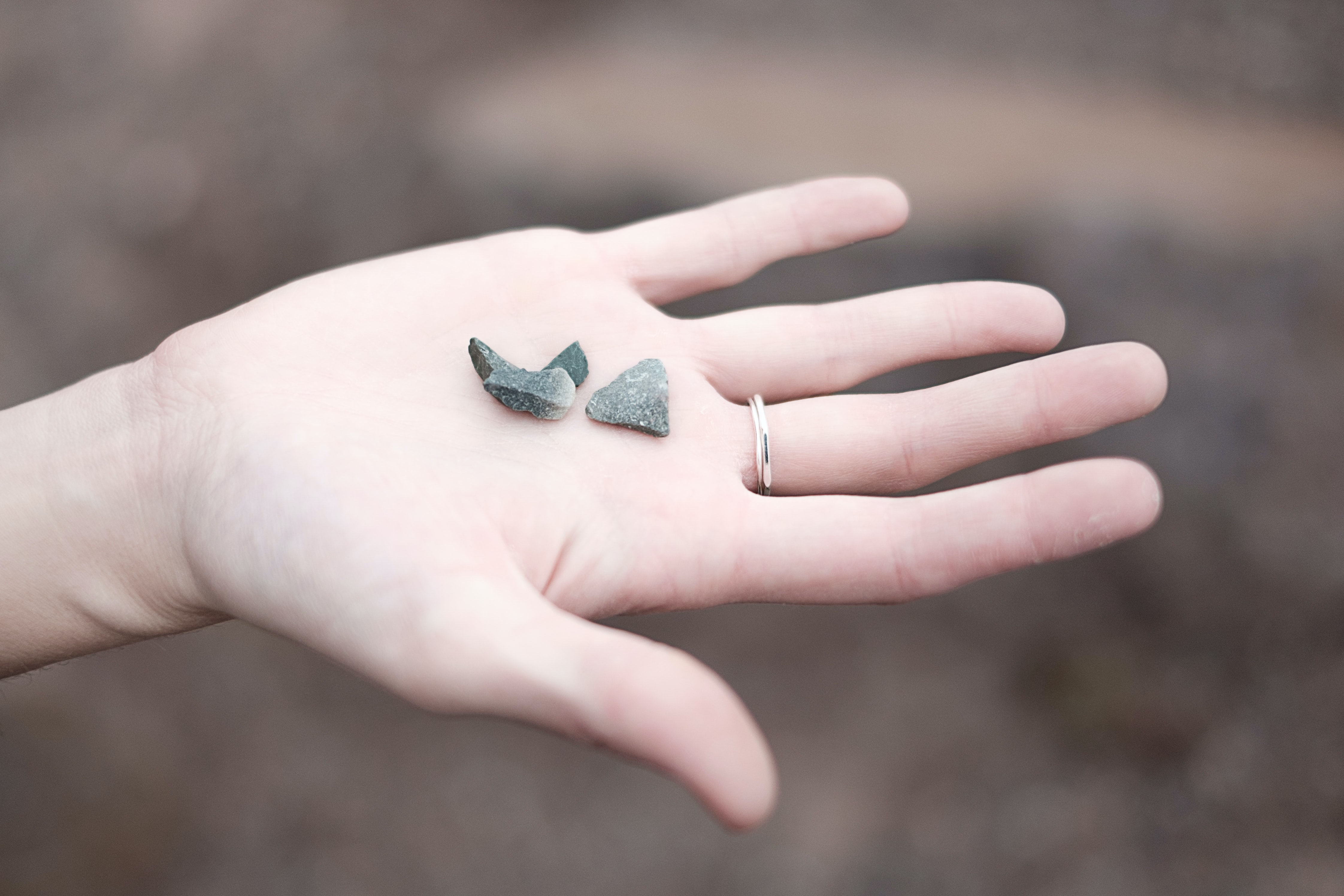Small stones in a person's outstretched hand