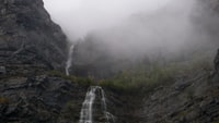 time lapse photo of waterfalls during foggy day
