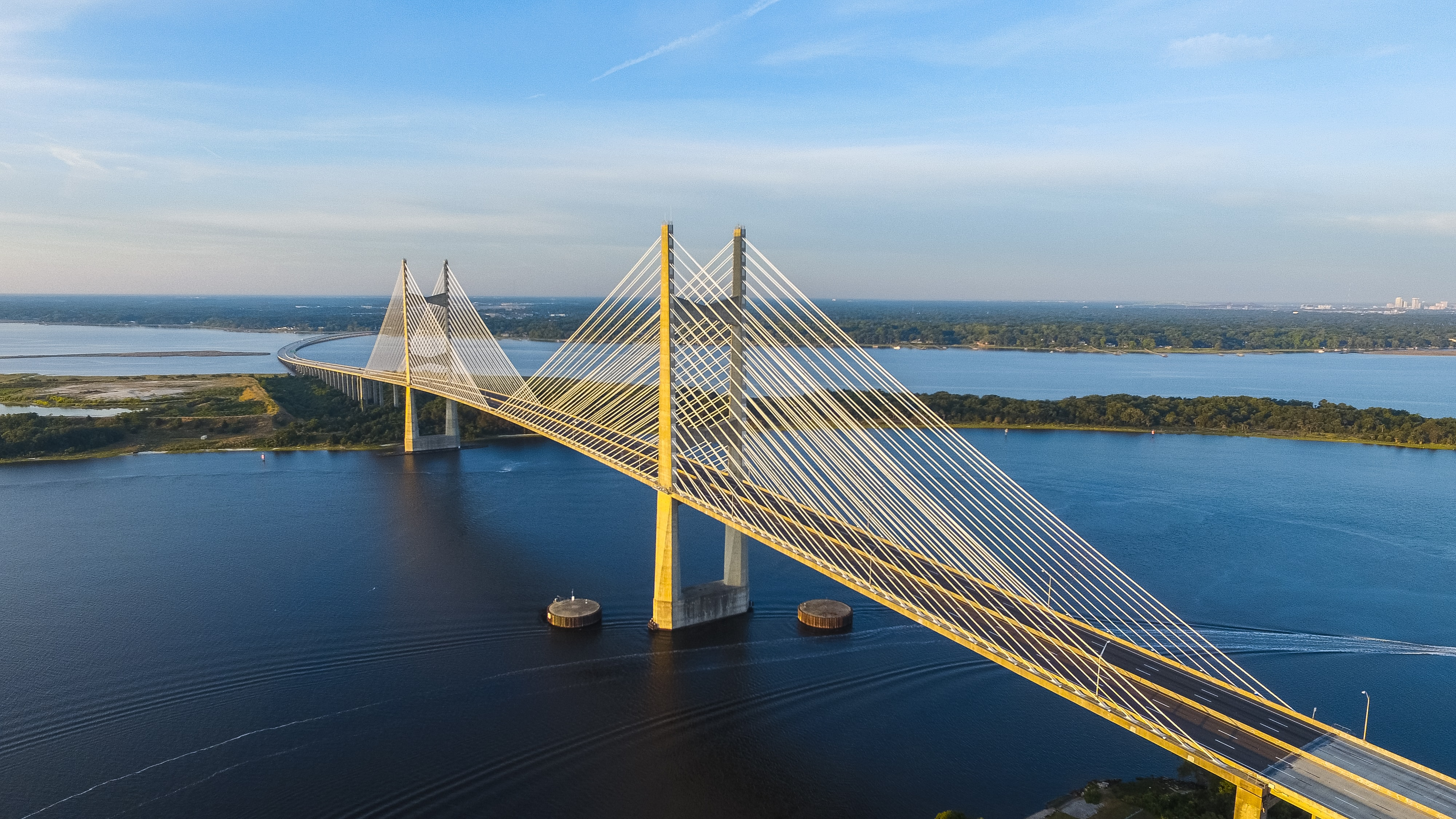 aerial photography of yellow bridge surrounded by body of water