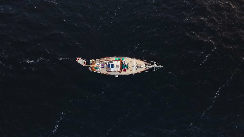 beige boat on aerial view