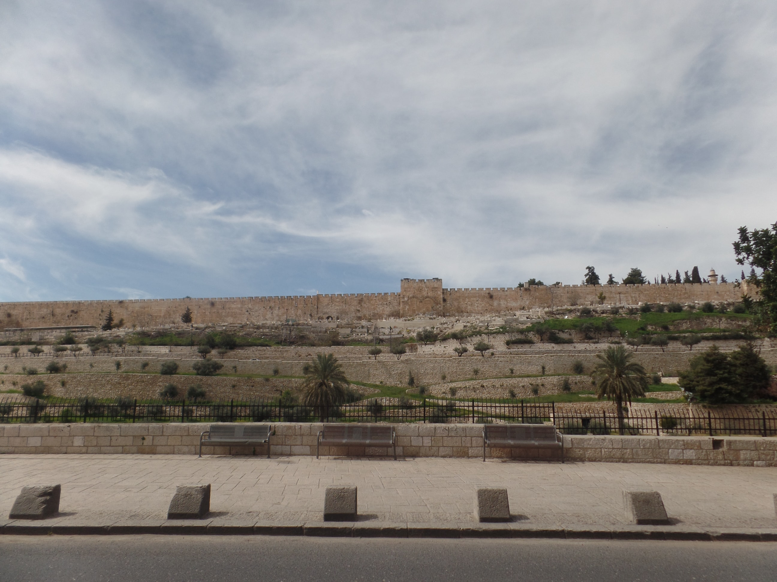 Benches against a wall in Israel.