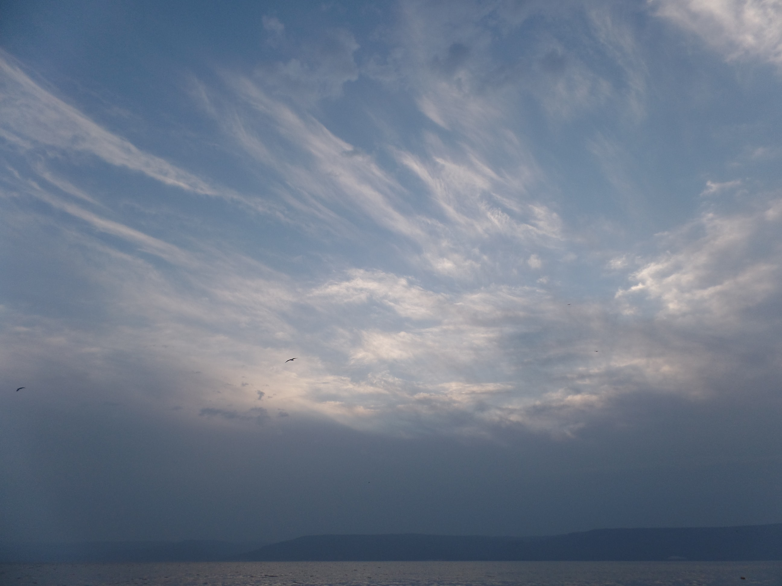 A blue cloudy sky.