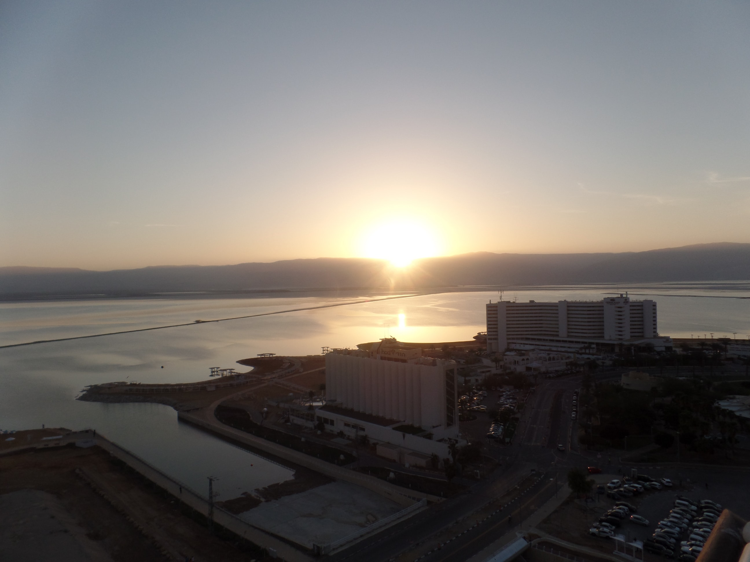 A sunset in the horizon, in a city in Israel.