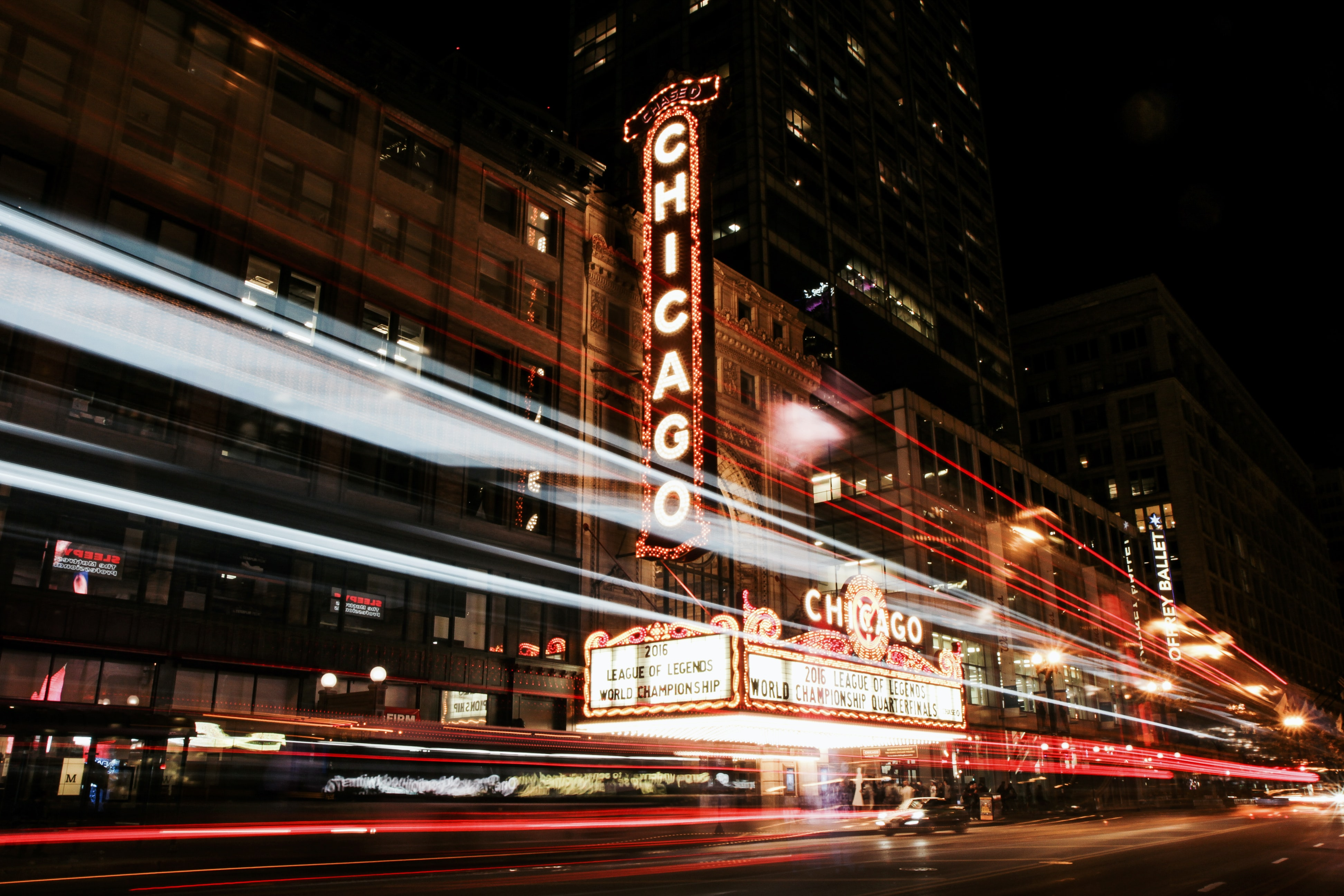 Long exposure of nighttime cars in Chicago with neon signs in the background