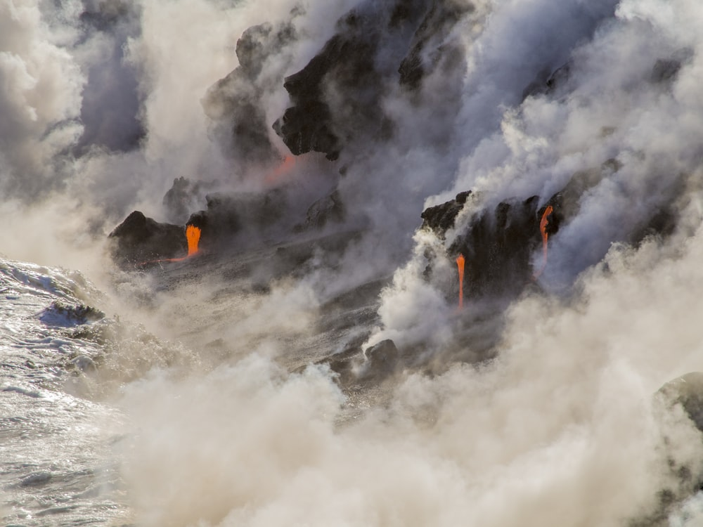 photography of volcanic eruption during daytime