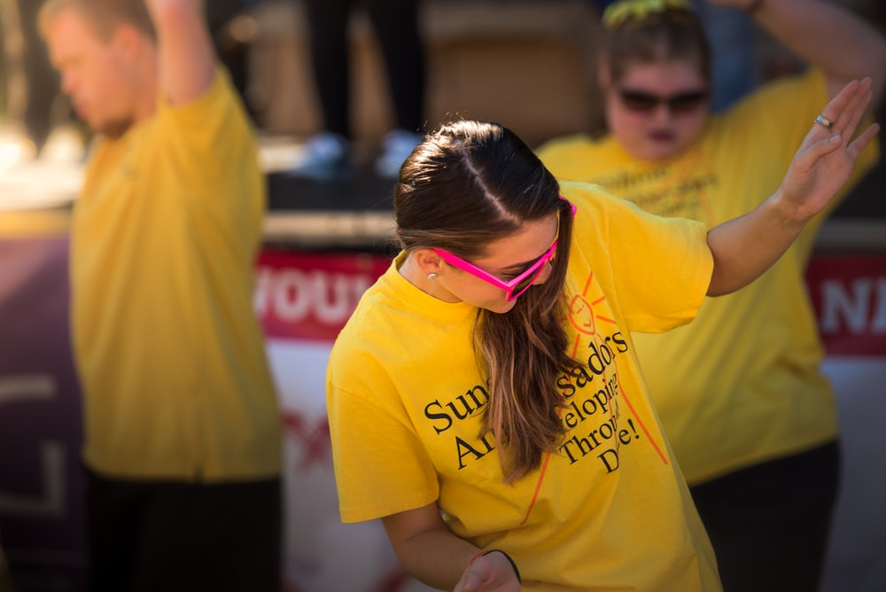 woman in yellow tshirt