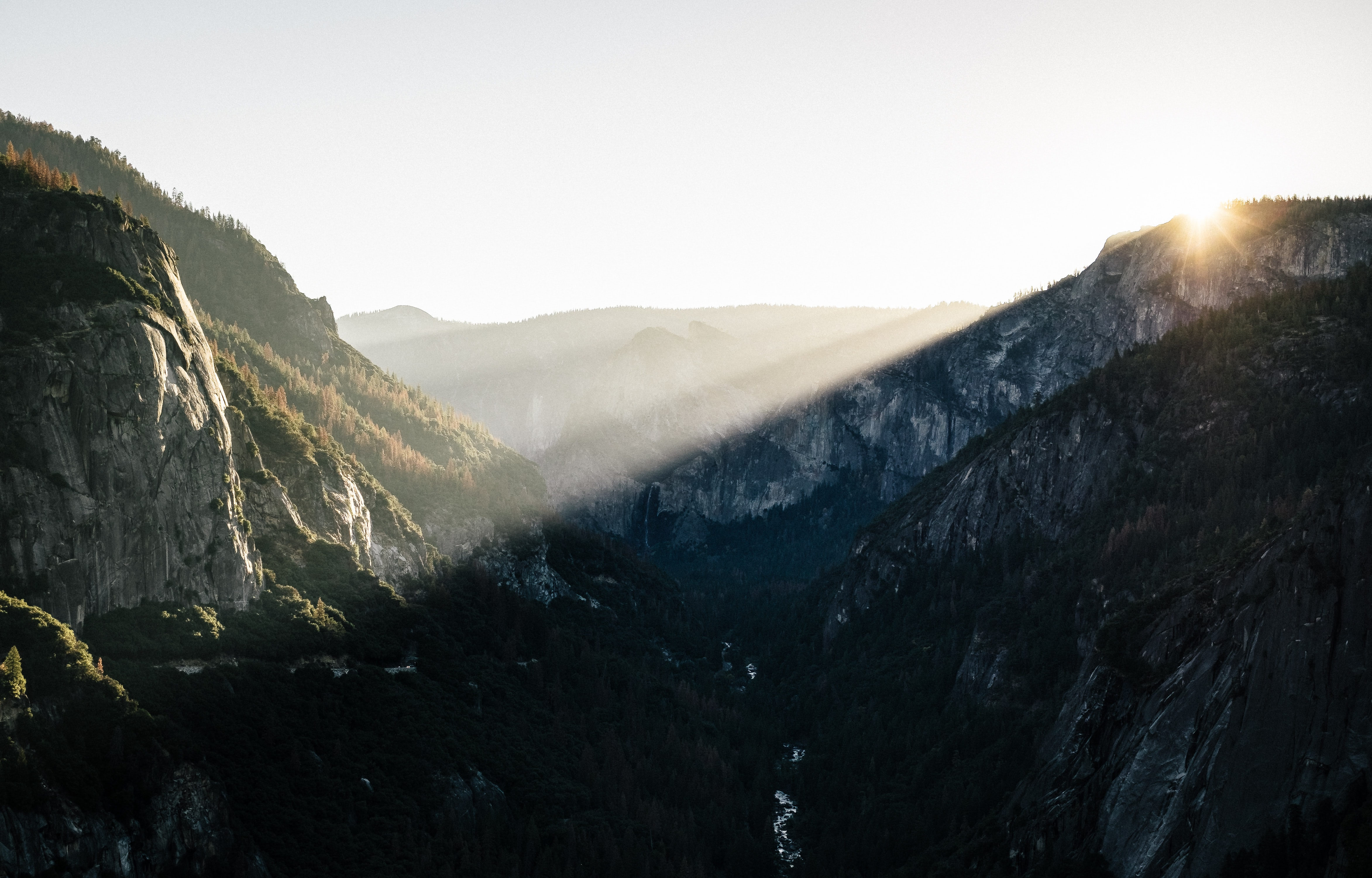 Sun's rays falling on the granite summits in Yosemite Valley during sunrise