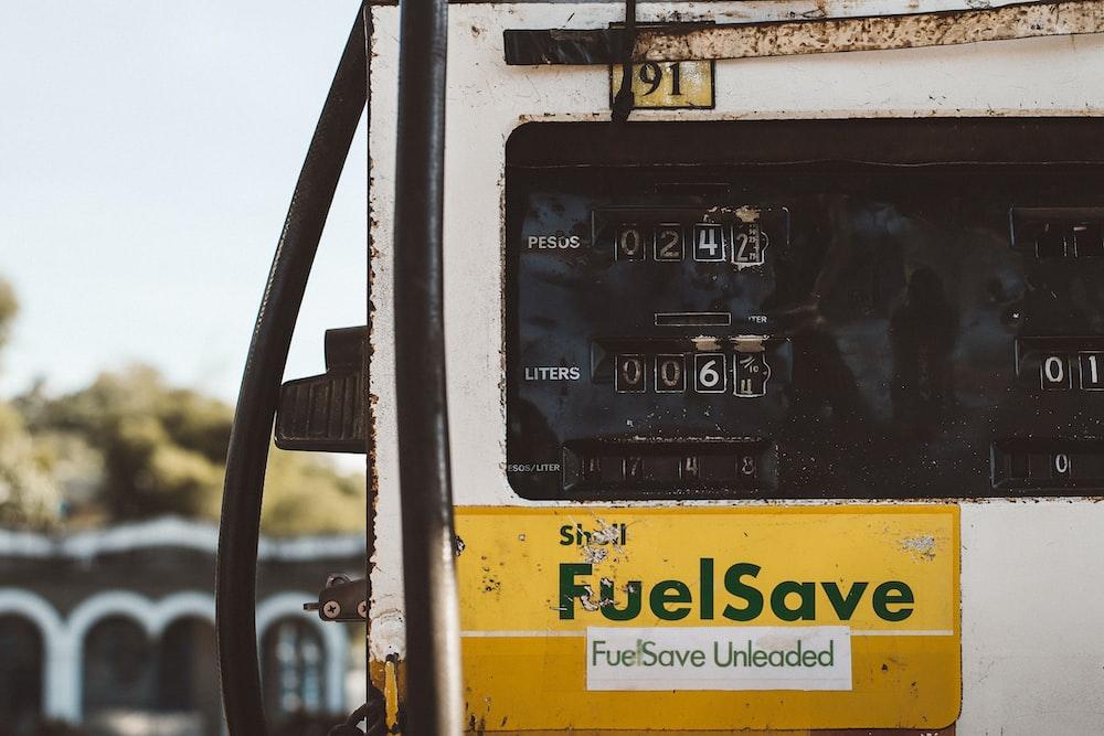 automotive fuel pump reading at 242 pesos