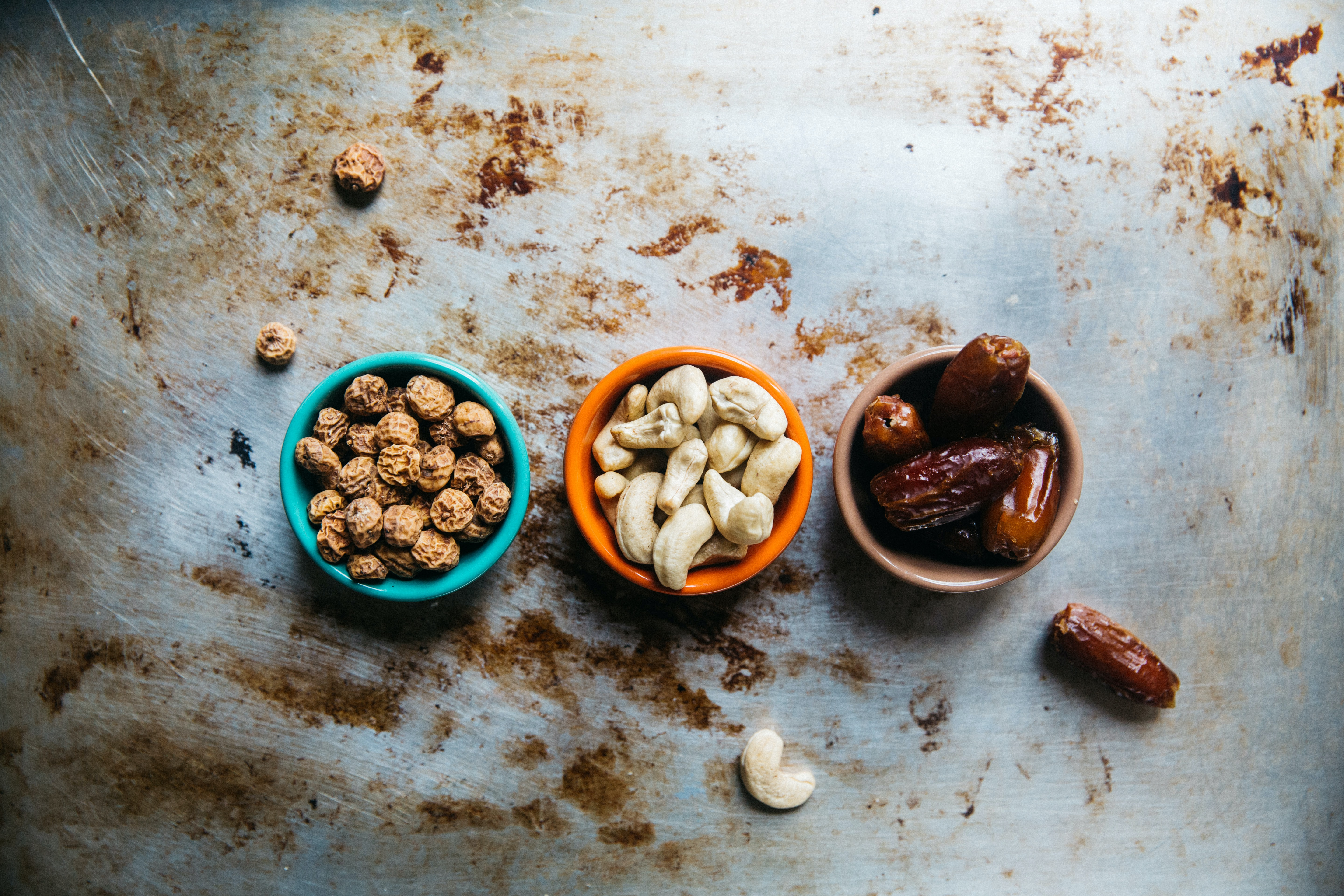Small bowls of nuts, cashews, and dates for snack