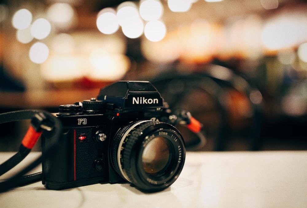 selective focus photography of black Nikon MILC-camera