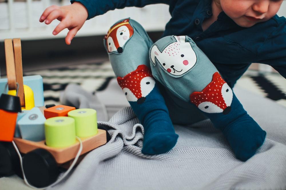baby boy wearing pair of blue socks