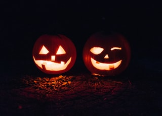 two lighted jack-o-lanterns during night time