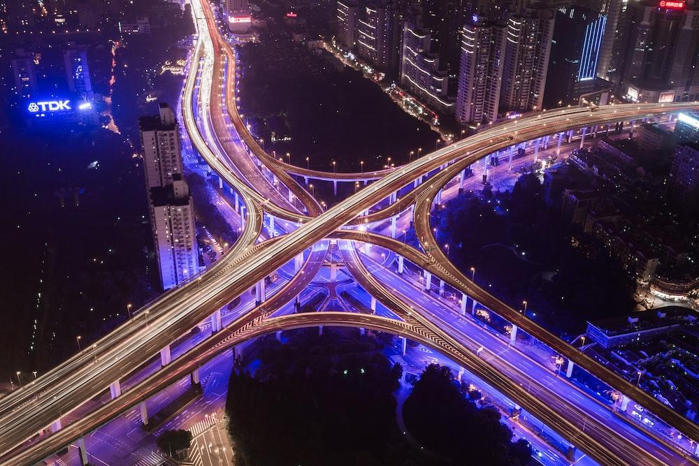 aerial photography of bridge near buildings