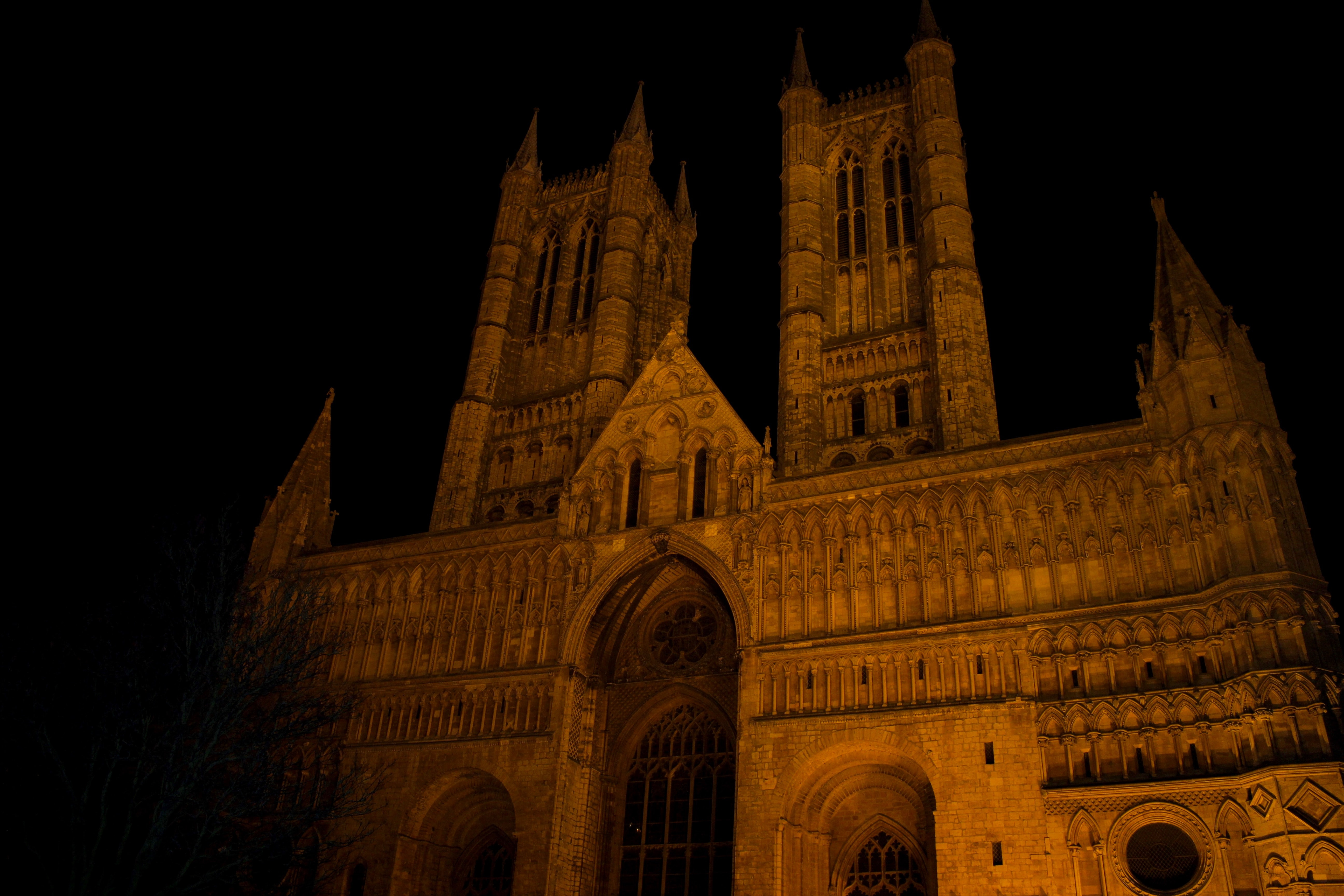 A view of a lincoln cathedral church with dark skies at night in lincoln