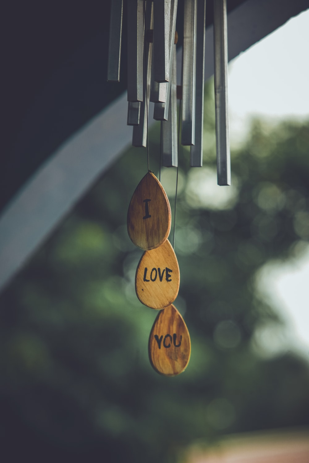 focus photography of gray and brown wind chimes