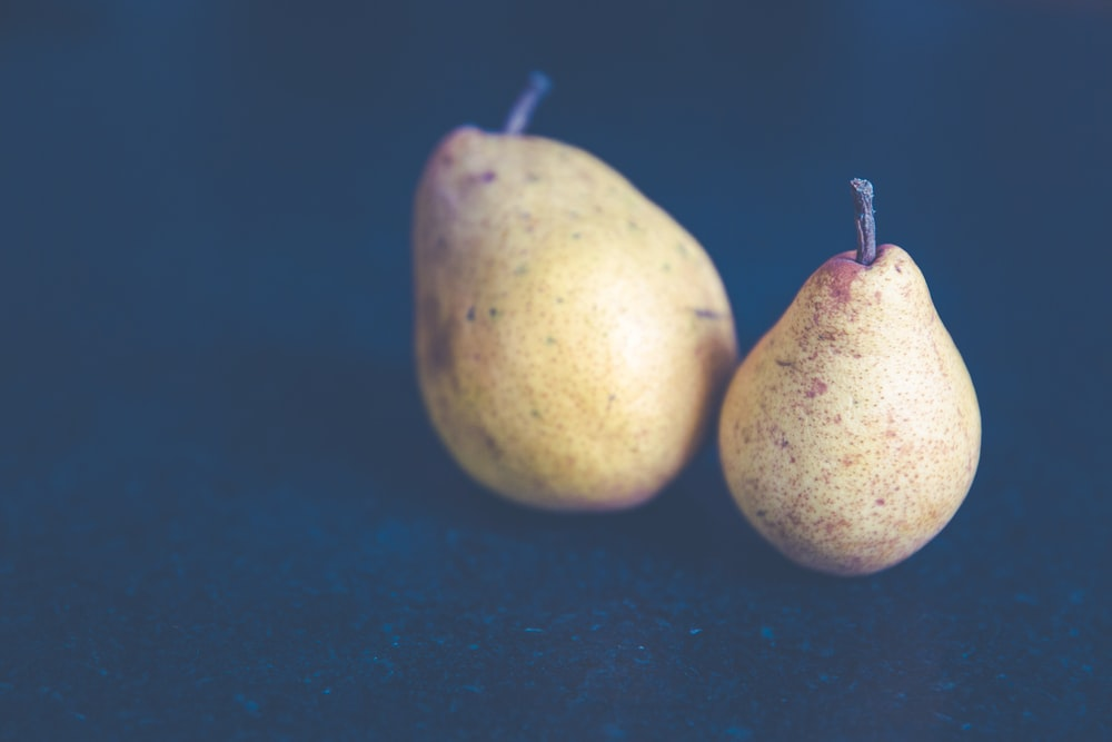 filtered photography of two pear fruits