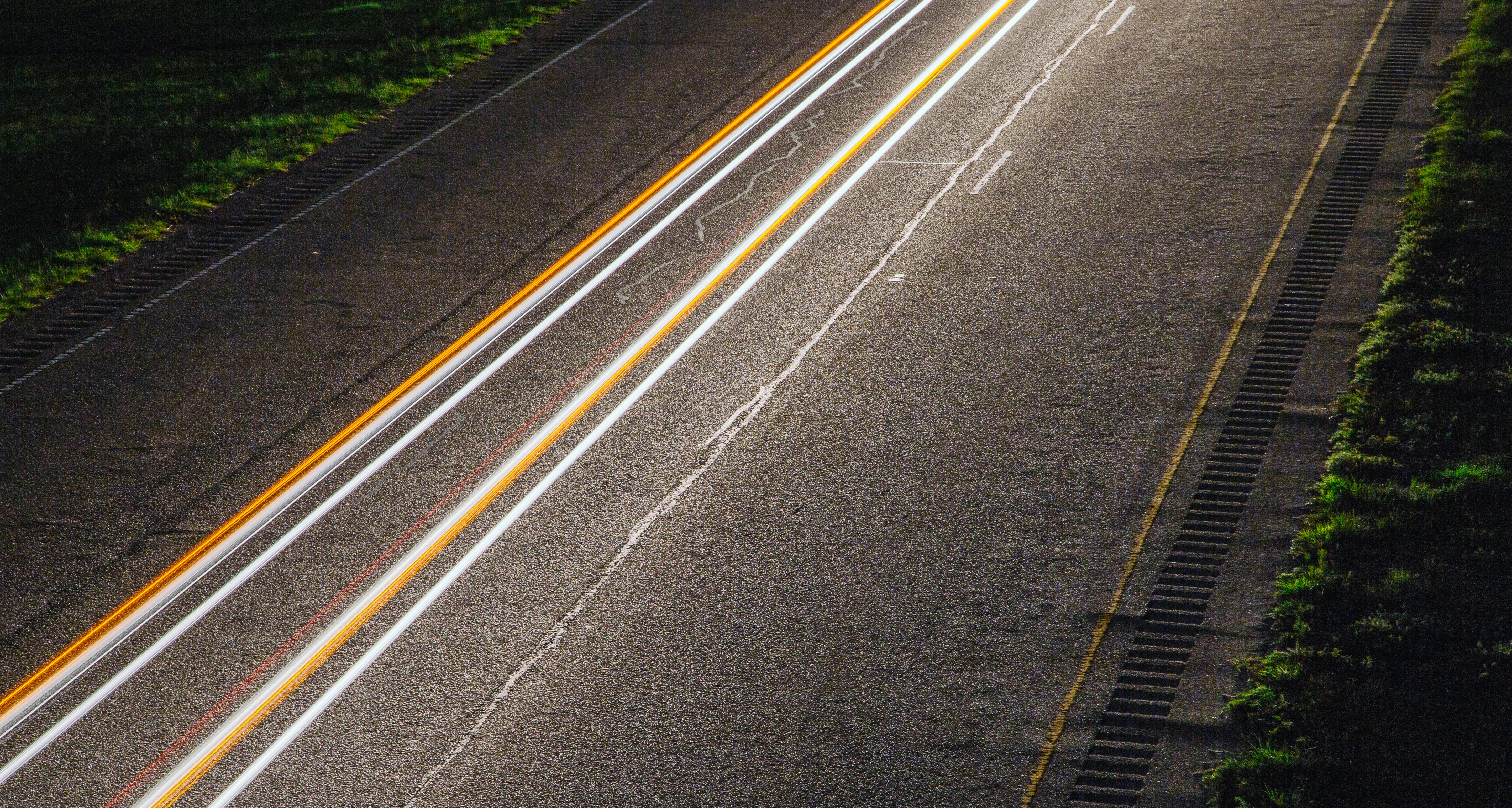 panning photo of light on road