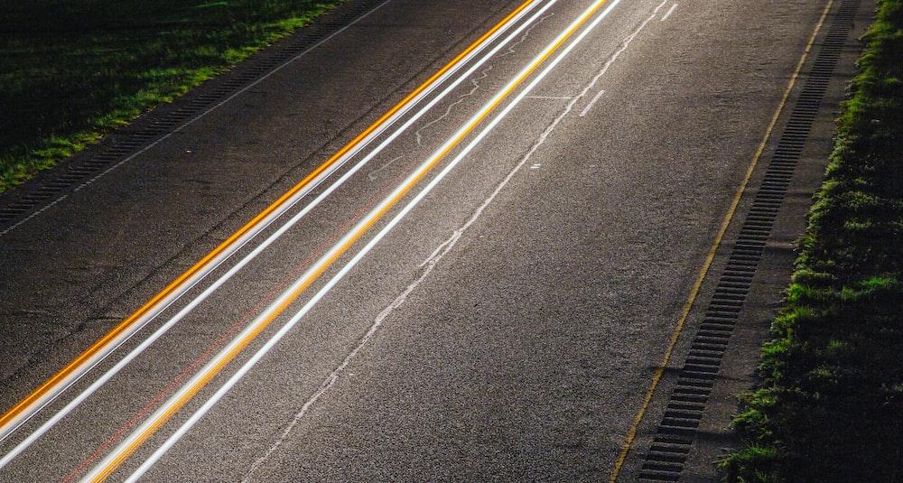 panning photo of light on road